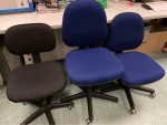 1 black and 2 blue office chairs on wheels